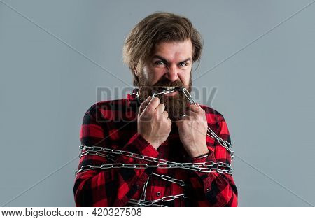 Man Chained, Try To Free Himself, Slavery Concept, Stiffness Of Movement