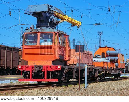 Railway Crane. Loading Locomotive With The Diesel Engines. Small Diesel Locomotive.