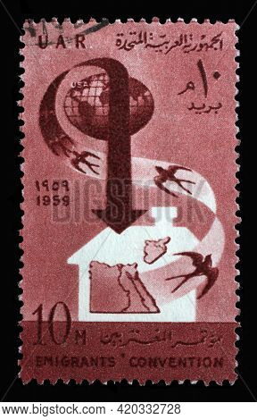 ZAGREB, CROATIA - SEPTEMBER 18, 2014: Stamp printed in Egypt shows Globe - Swallows - Map, Convention of the Association of Arab Emigrants, circa 1959