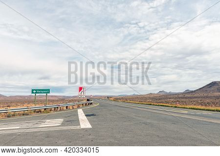 Turn-off From National Road N1 To Nelspoort In The Western Cape Karoo. Vehicles And Road Signs Are V