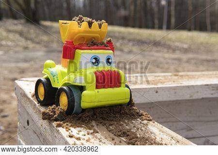 Children's Toy Car In The Sandbox. Sandbox.