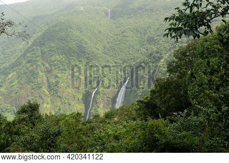 Magnificent Waterfalls In The Deep Dense Forests Of The Western Ghats. View From A Vantage Point.