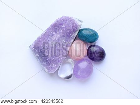 Tumbled Gems And Crystals Of Various Colors. Amethystdruze, Rose Quartz, Apatite, Rock Crystal On Wh