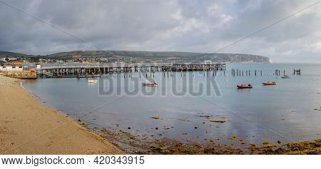 Morning City View In The South Of England On The Shore Of A Sea Bay With A Pier And Boats. Swanage B