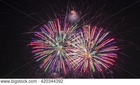 Long Exposure Of Fireworks Against A Black Sky. A Fireworks Display Against The Night Sky.