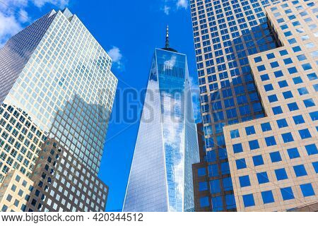NEW YORK, USA - FEBRUARY 2020: The One World Trade center or Freedom Tower located in New York City. Architectural modern buildings at lower Manhattan skyline. United States of America.