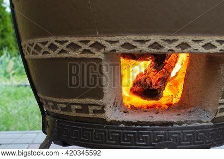 Fire In The Tandoor. Preheat The Tandoor Before Preparing The Kebab.