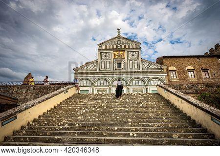 Florence, Italy - Aug 3, 2020: The Main Facade Of The Famous Basilica Of San Miniato Al Monte In Flo