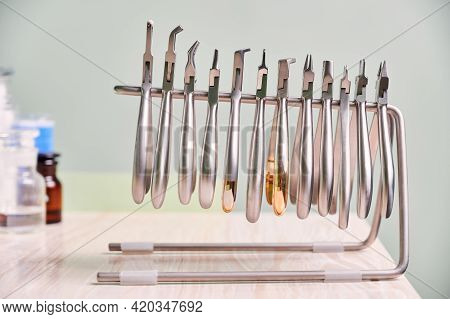 Set Of Different Stainless Steel Instruments For Braces. Silver Removing Pliers, Cutters, Removers,