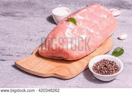 Raw Pork Loin On A Chopping Board