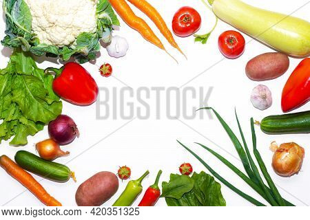 Vegetables Layout On A White Background . Home-grown Vegetables. Harvest. Window Dressing. Isolated