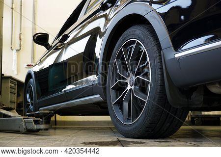 Moscow Russia - May 11 2021: Luxurious Black Modern Car In A Car Service. Car Service, Body Repair A