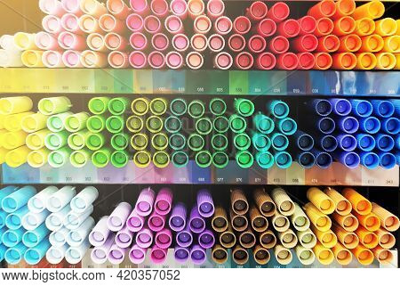 Multi Colors Highlighter Pen Line Up In Slots. A Large Number Of Multi-colored Markers