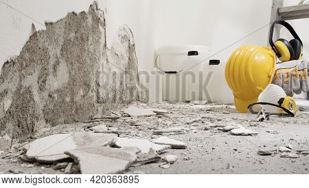 House Renovation Concept, Wall In Demolition With Plaster Rubble And Protective Construction Work To