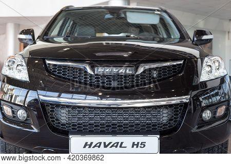 Russia, Izhevsk - February 17, 2021: Haval Showroom. New Modern Haval H5 Car In Dealer Showroom. Fro