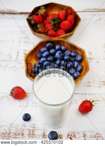 Morning Breakfast With Fresh Fruits And Yogurt Or Milk On A White Wooden Background, Closeup