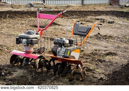 Two Options For A Plow Cultivator On Arable Land. Plows The Ground With A Tillerblock In The Garden.