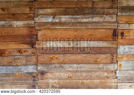 Orange Uncoated Wooden Planks Wall Suface Texture And Background