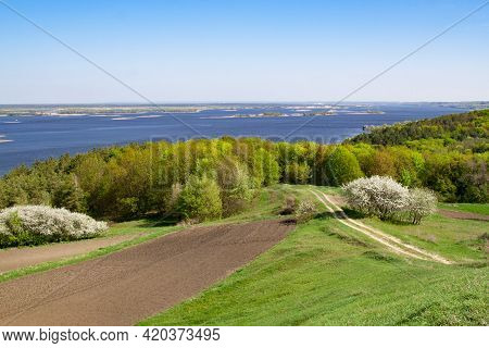 Spring On The Slopes Of The River. Springtime Scenery Of The River. Landscape Of The River.