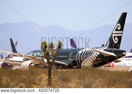 May 12, 2021 In Victorville, Ca:  Air New Zealand 777 Aircraft Stored During The Travel Slowdown Tak