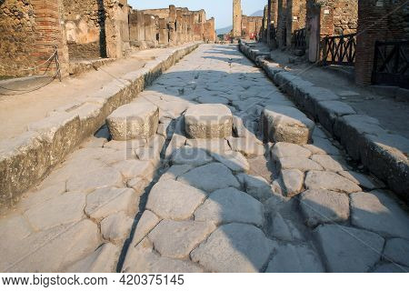 Very Old Cobblestone Street With Buildings On The Sides In Ruins, Fallen Or Half-ruined.