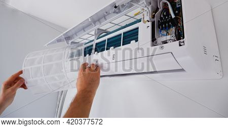 Air Conditioner Repair And Maintenance. The Engineer Of The Service Organization Carries Out Mainten