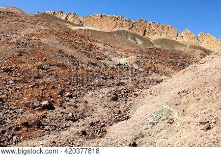 Arid Hillside Covered With Eroded Sedimentary Rocks And Sandstone On Rural Badlands Taken At The Moj