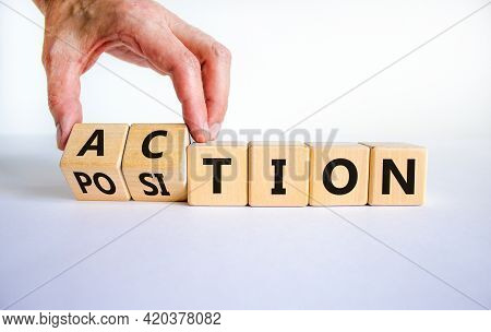 Action Or Position Symbol. Businessman Turns Wooden Cubes And Changes The Word Position To Action. B