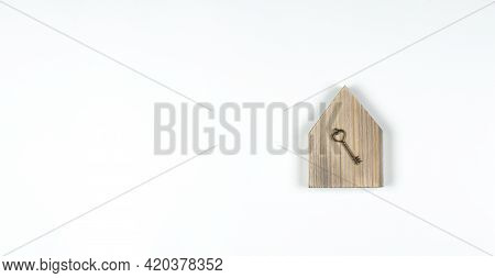 Miniature Model Of The House. Wooden House. Buying A House. Old Antique Key. Flat. On White Backgrou