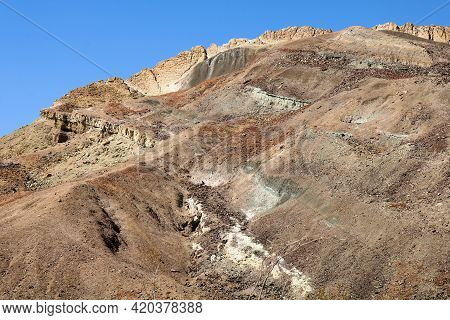 Eroded Hillside Covered With Sandstone And Sedimentary Rocks Rich With Minerals Taken On Arid Badlan