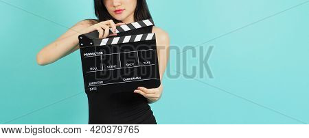 Black Clapper Board Or Movie Clapperboard In Young Woman's Hand .it Use In Video Production ,film, C