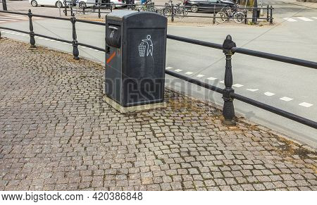Close Up View Of Metal Waste Container On Cobblestone Pavement Of European City. Sweden.