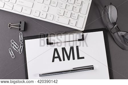 Office Paper Sheet With Text Aml And Keyboard. Business