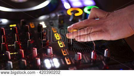 Dj Play On Music Console In The Nightclub
