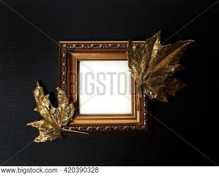 Gold frame. Golden leaf. Golden leaves on black background. Gold