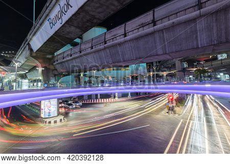 Bangkok Thailand , April 03 , 2021 : Bts Skytrain And Sky Walk Mbk Shopping Center With Car Lights O