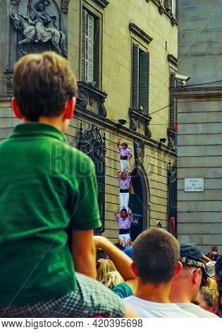 Barcelona, Spain - September 23, 1999: Crowd Of People Watch As Locals Are Building Human Towers (ca