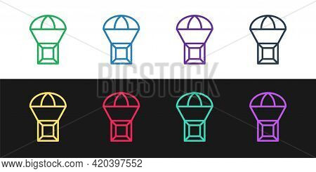 Set Line Box Flying On Parachute Icon Isolated On Black And White Background. Parcel With Parachute