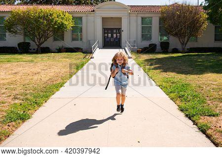 Kid School Boy Running And Enjoy School Vacation. Day Out Or Weekend. Vacation Or School Break. Kids