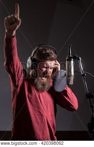 Handsome Man In Recording Studio. Music Performance Vocal. Singer With Expression Face Singing Song