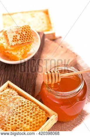 Glass Pot With Floral Honey Isolated On White Background
