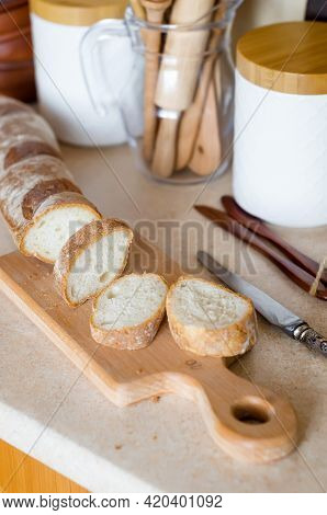 Sliced French Baguette. Ingredient For Breakfast, Fresh Baguette And  Tomatoes On Background Kitchen