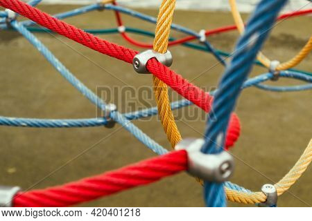 Colorful Ropes On The Sports Ground. Connections Of Rope Ropes For Training.