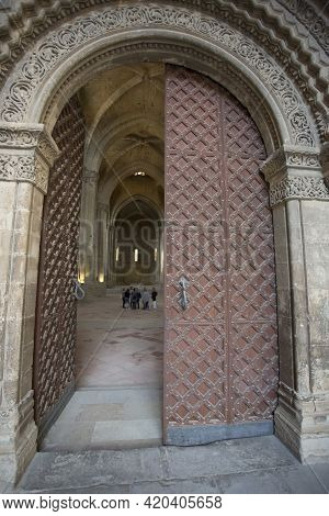Lleida, Spain, May 1, 2020 - Beautiful Medieval Wooden Gates Of La Seu Vella Cathedral. Gothic Archi
