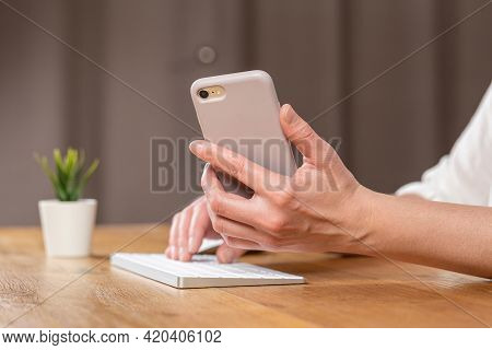 Hands Of Women Who Use Laptop Keyboard And Mobile Phone. Concept Of Email Delivery And Use Of Online