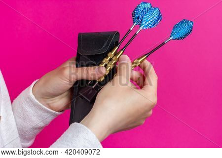 Choosing A Dart. Three Darts In The Hands Of The Player.