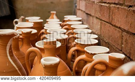 Close-up Photo Of Clay Jugs. Rows Of Handmade Earthenware Jugs. Handicraft Products