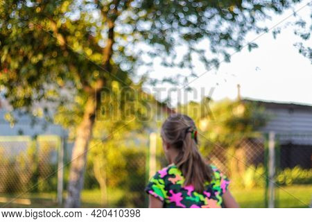 Defocus Abstract Bright Yellow Colorful Sport Background. Person Back. Skate Penny Board. Girl Run.