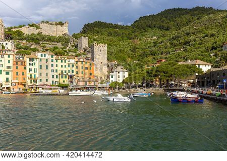 Porto Venere, Cinque Terre - Italy, May 12, 2019: View On Seaside And Boats In The Port, Typical Col