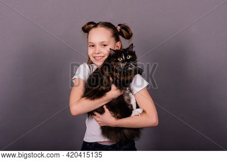 Portrait Of Little Girl Playing With Her Pet, Black Big Cat